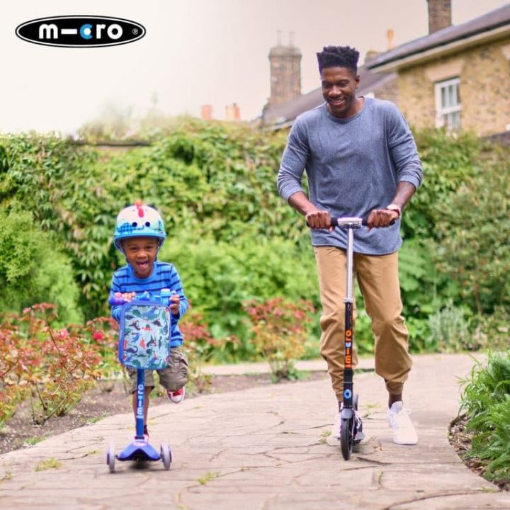 kid and man riding Micro Scooters